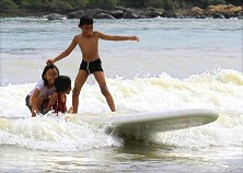 Wanna learn how to surf? Come on down. Even kids can do it!