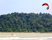 Kite-surfing against a gorgeous backdrop. This is kite-surfing Malaysia Sea Sports!